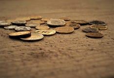 Monety na stole Zdjęcie Royalty Free