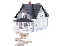 monety przed domowym architektonicznym modelem Zdjęcia Royalty Free