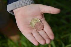 Monety w ręce zdjęcie royalty free