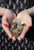 Monety w rękach dziewczyna Obraz Stock