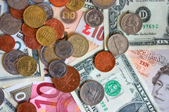 Money. Selection of notes and coins from major currencies stock photos