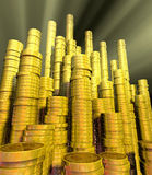 Money. Spotlighted golden coins arranged in stacks Royalty Free Stock Image