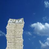 Money. Conceptual image of 10 dollar bill on blue sky background stock image