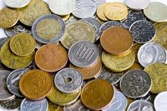 Money. Rouble, euro, crone, yen - coins Stock Photo