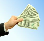 Money. In hands on sky Royalty Free Stock Photo
