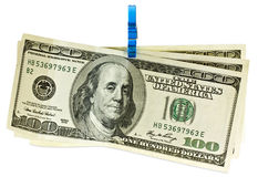 Money. Dollars on clothes-peg over white Stock Images