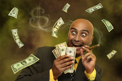 Money. Businessman with dollars flying all around Stock Photography