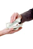 Money. Two man's hands with money isolated at the white background Royalty Free Stock Photography