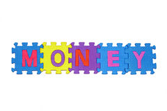 MONEY. Letters-puzzle, word Money,  isolated on white background Royalty Free Stock Photos