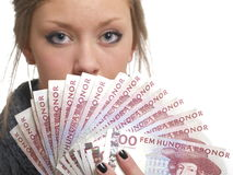 Money. Girl holding money from sweden 500 kronor bills Stock Photos