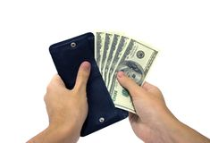 Money. A mans hand taking out money from the wallet. Clipping path included Royalty Free Stock Images