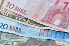 Money. Euro and dollars as a symbol of wealth Stock Photos