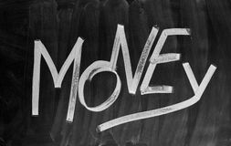 Money. The word Money written with chalk on a blackboard Stock Image