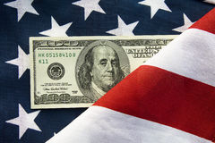 Money. Hundred American dollars lying on a flag usa Stock Images