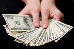 Money. Close-up of a hands holding $100 banknotes Royalty Free Stock Image