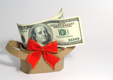 Money. Cardboard basket with red bow and money Royalty Free Stock Images