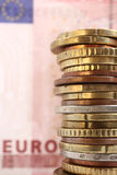 Money. Euro coins and euro bank note as background Stock Photos