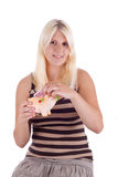 Money. A young woman puts a note in a piggy bank Stock Photography
