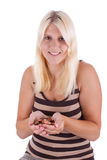 Money. A young woman with a hand full of coins stock photos