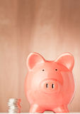 Money. Piggy bank and coins on an abstract background royalty free stock photography