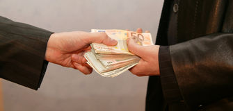 Money. One men give some money to another men Royalty Free Stock Photography