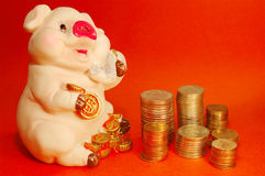 Money. And a pig holding dollars Royalty Free Stock Photo
