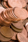 Money. Dirty copper coins tilted at an angle Stock Images