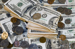 Lotto. Money - Dollar bills and coins over the table Stock Photography