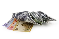 Money. Roled money from Quanza to Dolar Royalty Free Stock Image