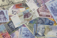 Money. A carpet of several currencies canadian dollar, won, american dollar Stock Photo