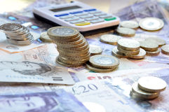 Money. British Pound sterling notes and coins stock image