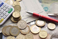 Money. British Pound sterling notes and coins royalty free stock image
