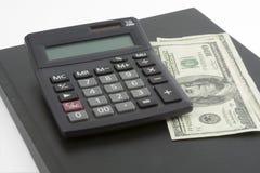 Money 2. Money, calculator and ledger Royalty Free Stock Image