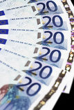 Money - 20 Euro Notes Detail. Money - Details Of 20 Euro Notes - Focus On Top royalty free stock photo