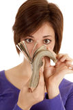 Money. A woman fanning her money up in her face Royalty Free Stock Photo