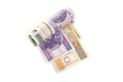 Money. Rolled polish money on white Stock Photo