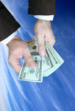 Money. Hands, money and blue sky Stock Photography