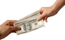 Money. One hand transfers money another stock photos