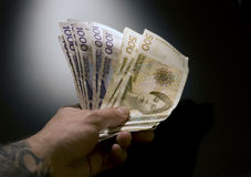 Money. Norwegian banknote with tattooed hand,black money Royalty Free Stock Image