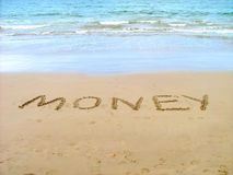 Money. Written in sand royalty free stock photo