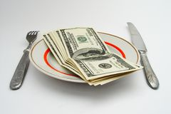 Money. On the plate. Business dinner Royalty Free Stock Photography