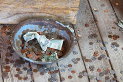 Money. Begging for money, coins in a pan stock photography