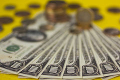 Money. On a table - bills and coins Stock Photography