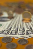 Money. On a table - bills and coins Royalty Free Stock Photography