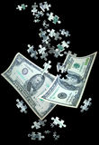 Money. Falling with puzzle pieces coming from the top.  Concept for  solutions Royalty Free Stock Photo