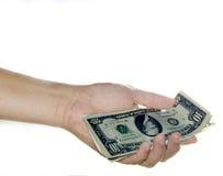 Money. A hand holding money Stock Image