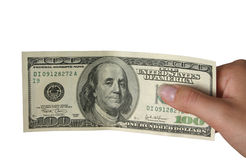 Money. Hand holding one hundred dollar note, pure white background Royalty Free Stock Photos