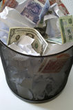 Money. In bin - different sorts of world currency Royalty Free Stock Photos