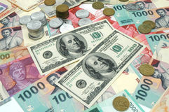 Money. US Dollar and Indonesian Rupiah Stock Photo