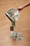 Money. Dollars falling from dustpan stock photos